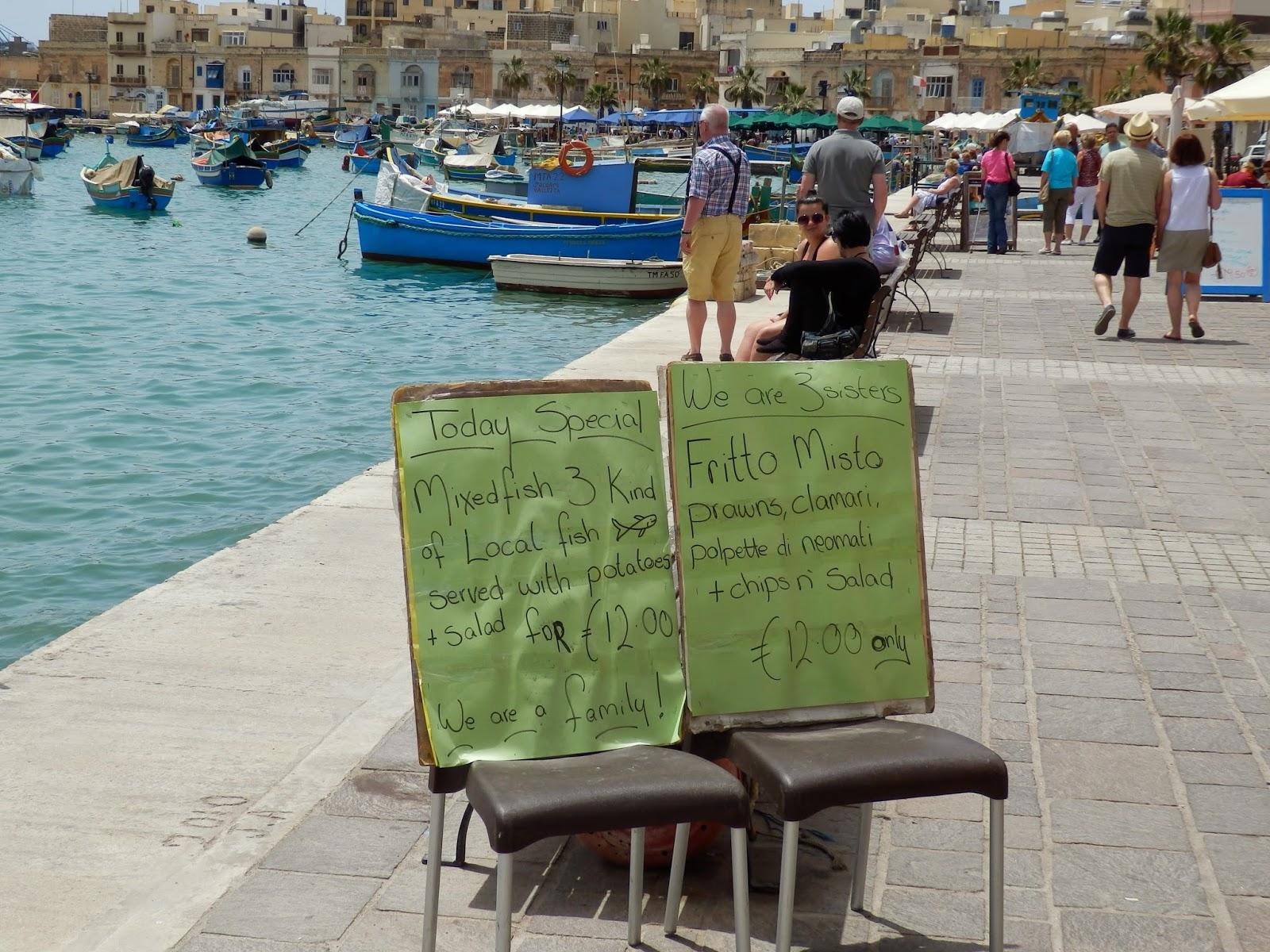 Fish restaurant signs Marsaxlokk, Malta