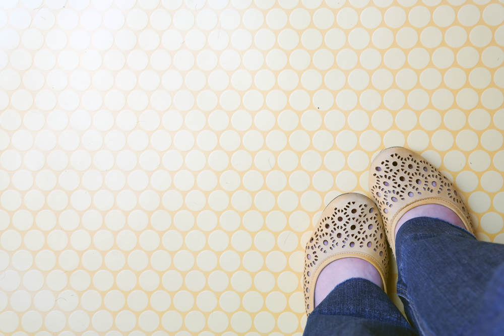 Feet in yellow shoes on a yellow floor