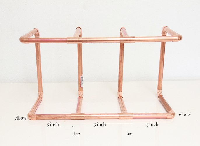 A bubbly life diy copper pipe leather wine rack for How to convert copper pipe to pvc