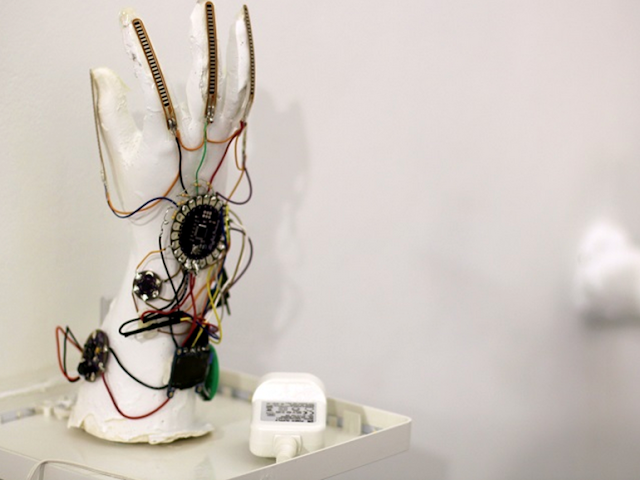 """Hadeel Ayoub, a designer and student of Goldsmiths, University of London has developed a smart glove that translates sign language from hand gestures to visual text on a screen and audible dialogue. The wireless SignLanguageGlove is designed to make communication easier for those with disabilities or impediments, and has already gone through three prototype stages.  The original version of the SignLanguageGlove translated sign language gestures into visual letters on a screen, which comprised of flex sensors, an accelerometer, a microcontroller board, and a four digit graphic numerical display. Five flex sensors were attached to the glove to track five fingers, to detect bends and curvatures then reporting the values to a serial monitor. An accelerometer was attached to detect the orientation of the hand.  Hadeel also developed a computer programme that recognizes the output values of the sensors and accelerometer and matches them with a series of statements that determine what letters to display on a screen.  She then followed up with a second prototype with an improved model that was faster and more robust, featuring smaller, more discreet hardware and text that scrolled on a screen, deleting the old and adding the new. The third and latest prototype features a text-to-speech chip with the hardware sewn into the lining of the glove. This model went on to be displayed at the Goldsmiths MA/MFA Computational Arts end-of-degree show earlier this month.  """"I didn't want all the wires to intimidate users, making them feel the glove will be complicated to use or really fragile,"""" Hadeel explained. """"People tend to lean to the cautious side when approached with new high-tech products which contradicts the main purpose of this glove, which is to help make lives easier.""""  Hadeel is now working on the fourth prototype of the device, which will include an accompanying smartphone application that will receive the glove's output through Wi-Fi. As an Arabic, French and English spea"""