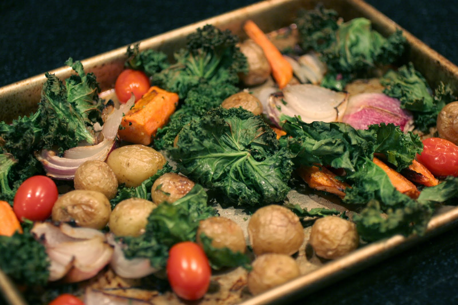 Roasted veggies (new potatoes, carrots, red onion, kale and tomatoes ...