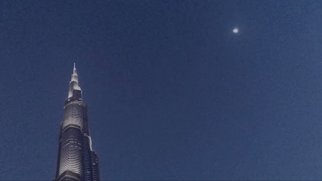Burj dominating the sky along with the Holy moon of Ramadan