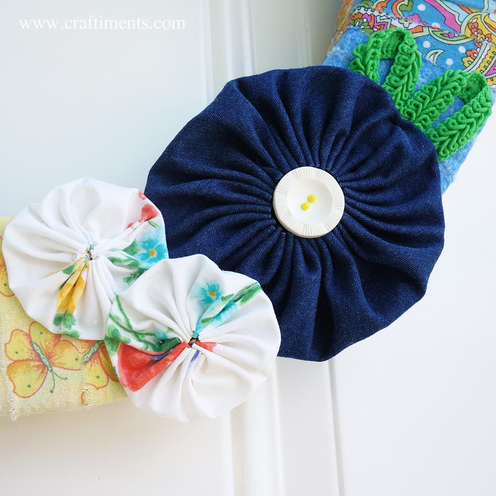 Fabric yo-yo flowers and gimp braid trim
