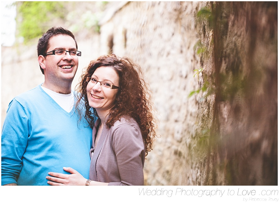 couple smiling at camera for engagement photo