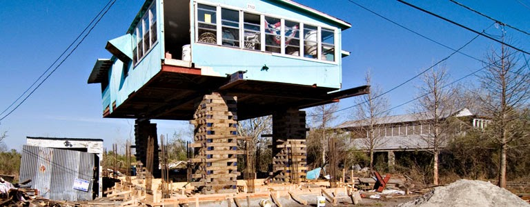 A house being raised against future storm surges. Costs of defending against and adapting to various climatic changes could be vastly underestimated, according to new research. (Credit: Paul Goyette/flickr) Click to enlarge.