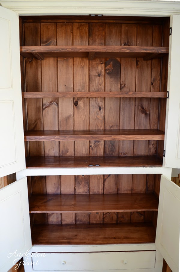 Staining the inside of this pantry keeps the paint from being chipped by boxes and cans | www.andersonandgrant.com