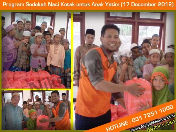 Sedekah Nasi Kotak untuk Anak Yatim