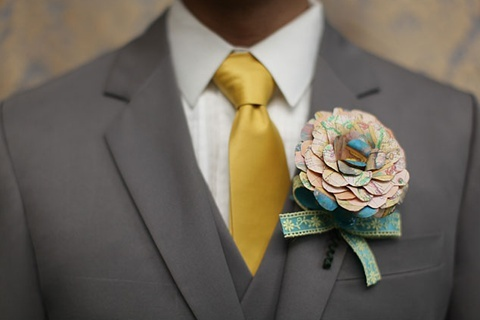 A quirky boutonnière made from paper printed with an antique world map