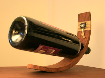 Good Glass makes wooden wine bottle holders decorated with wire and beads