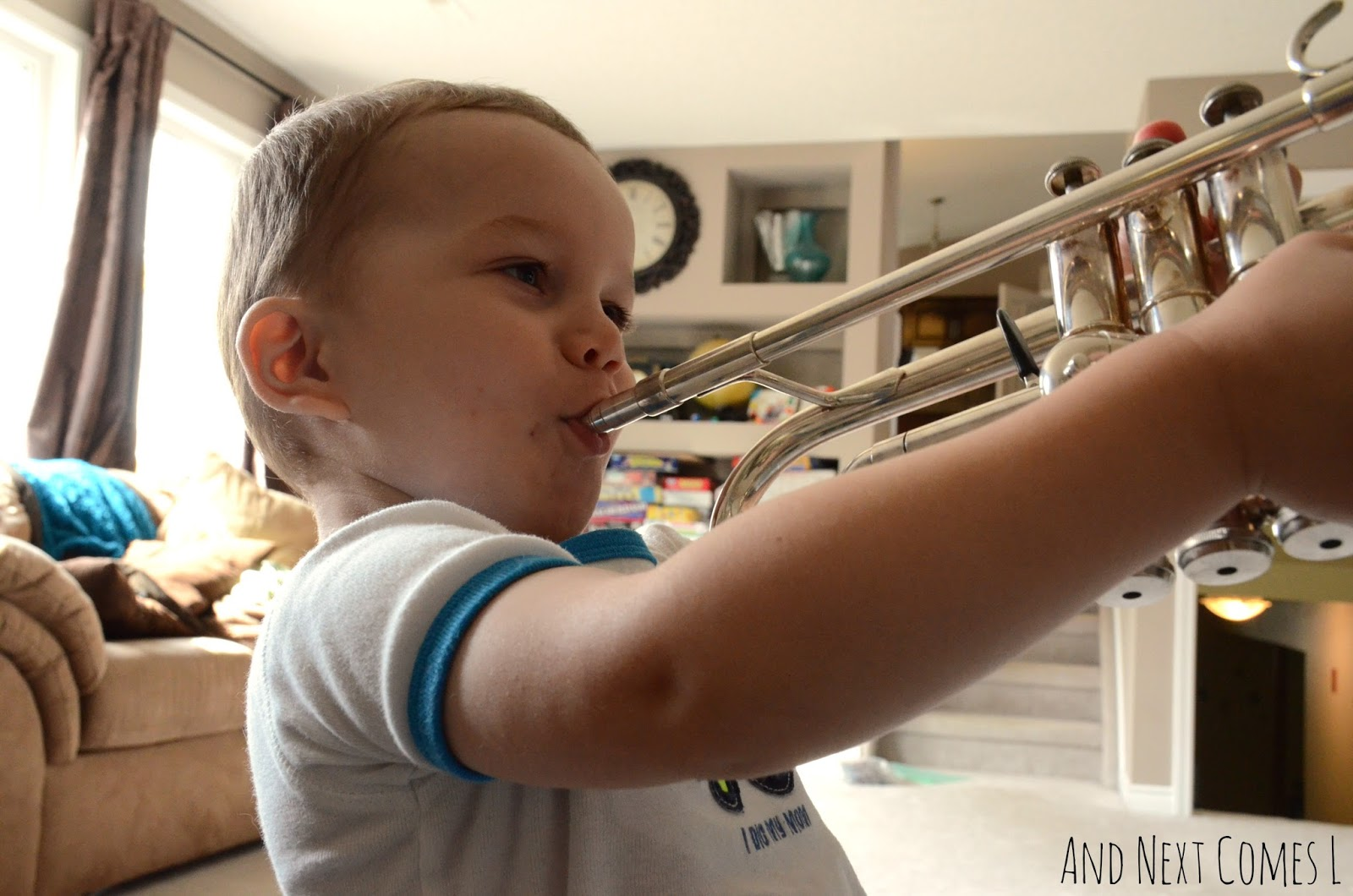 K playing the trumpet from And Next Comes L