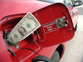 Dollar Being Stuffed in Gas Tank