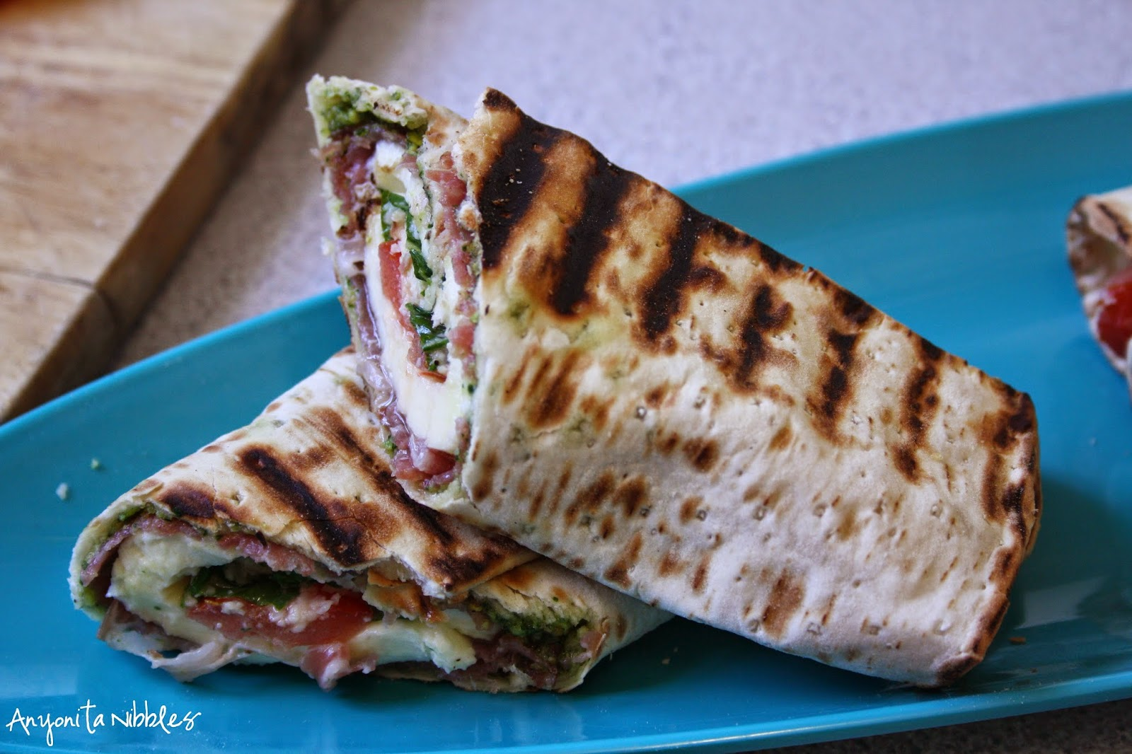 A sliced grilled caprese antipasti wrap from Anyonita Nibbles