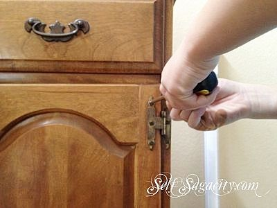 removing the hardware on cabinet door