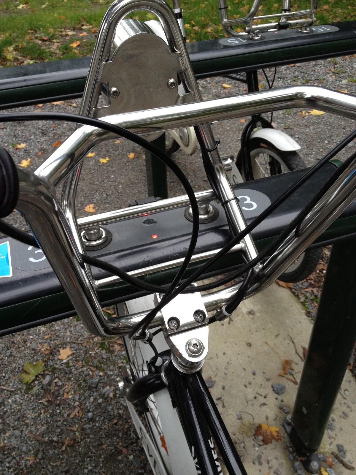metal basket connects bike to bike stand