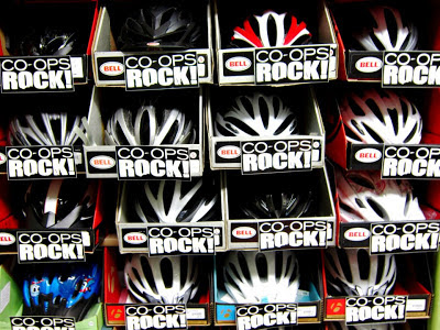 "Boxed bicycle helmets with ""Co-op Rocks"" promotional labels"