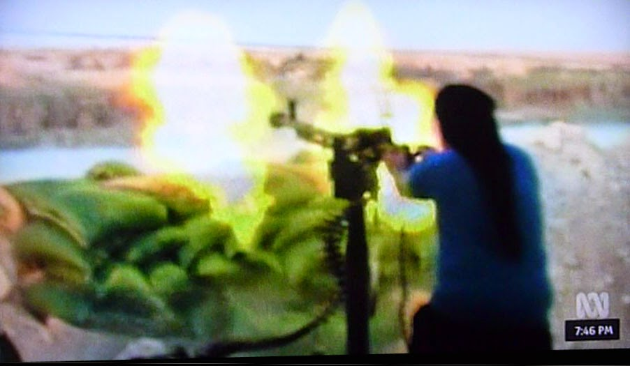 machine gunner firing weapon in northern Iraq