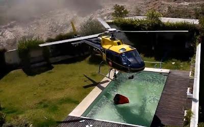 Piloto de helicóptero abastece numa piscina pequena em Braga (video)