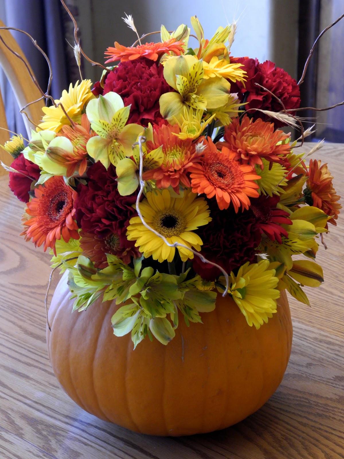 The flower girl fall flowers and a pumpkin