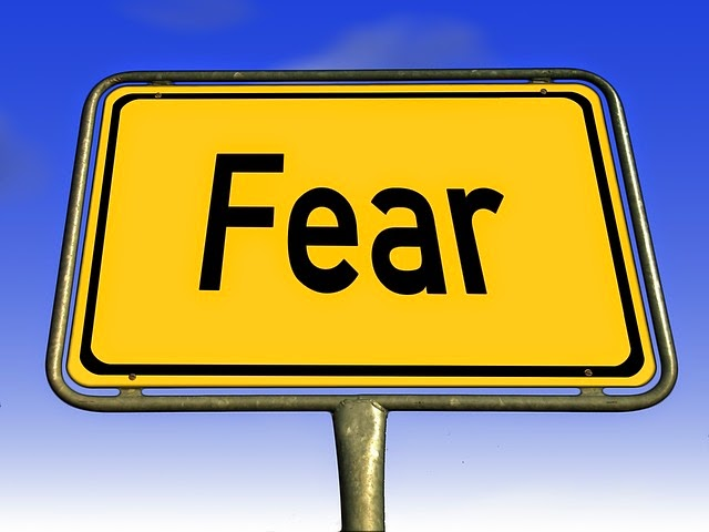 Fear wrote in a yellow road sign