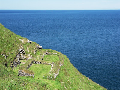 Dwellings on cliff side at Tintagel Castle