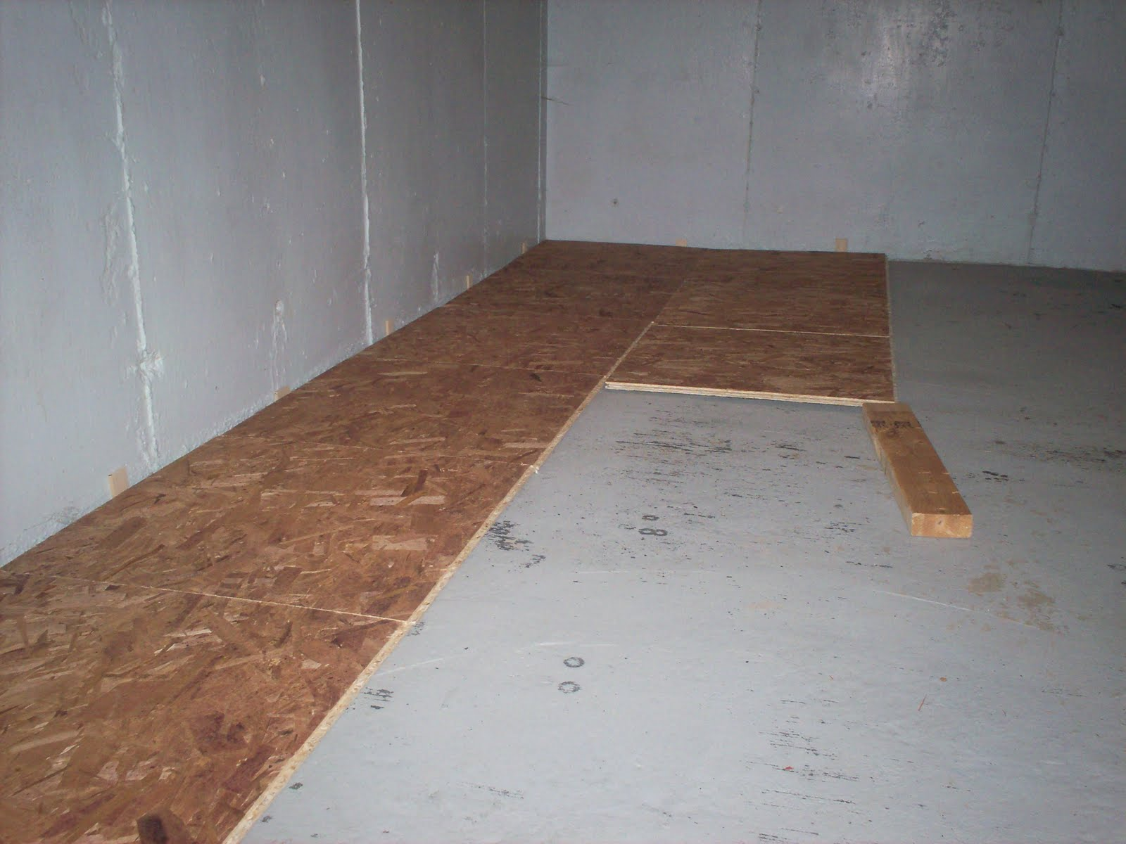 Tiling basement floor over concrete