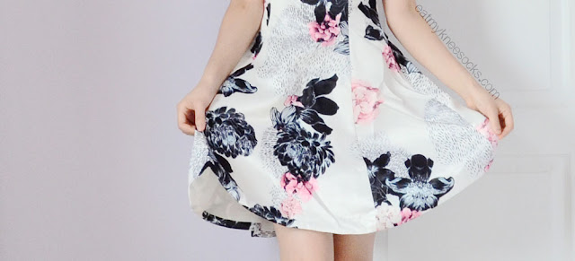 Close-up of the flared hem on Romwe's floral halter skater dress.