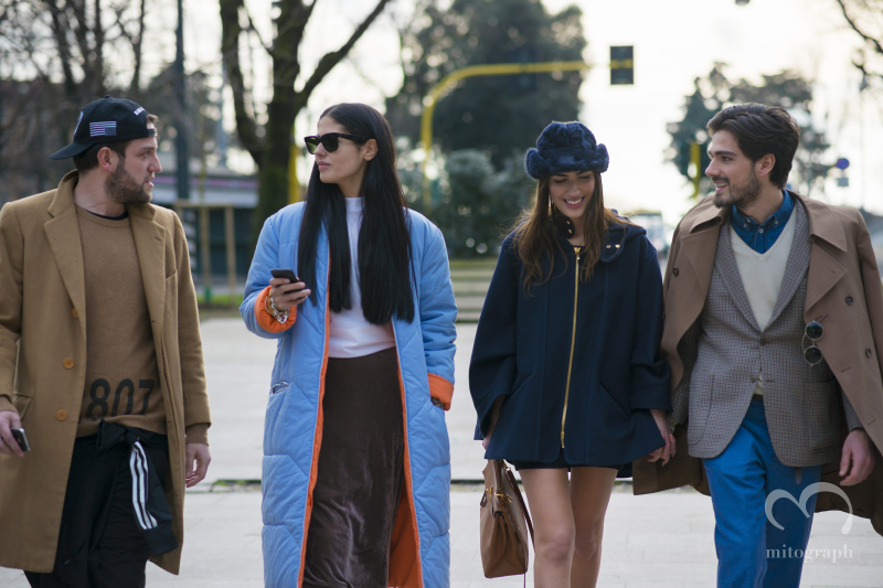 Two men and two women walked toward show location of Costume National at Milan Fashion Week 2014 Fall Winter MFW Season