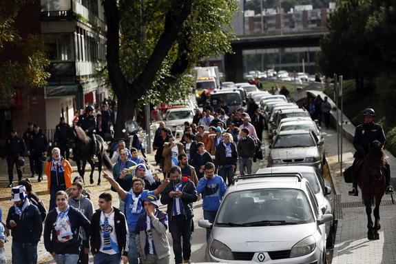 Spanish police escort Deportivo La Coruña fans upon leaving the Vicente Calderón Stadium