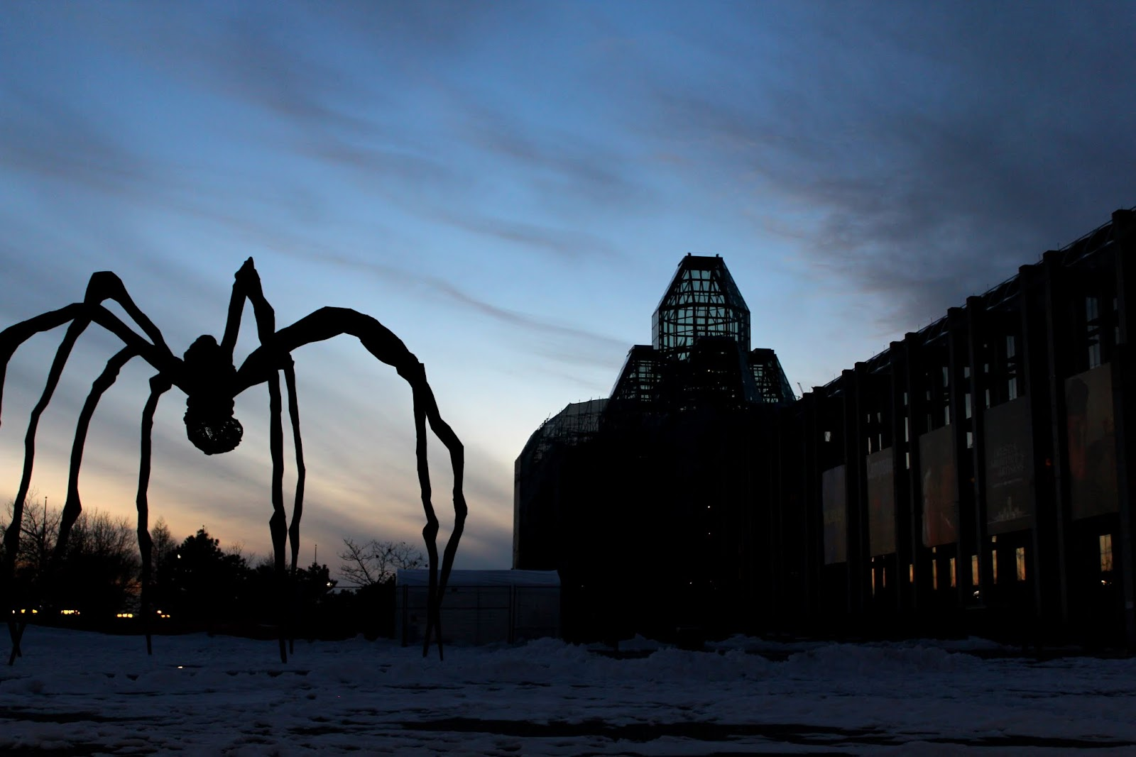 Maman and National Gallery of Canada, Ottawa, Ontario, Canada silouetted against sunset
