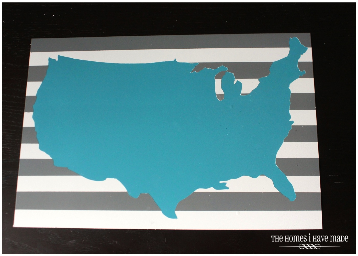 next very carefully peel off the vinyl cut out of the usa to reveal your original color popping through
