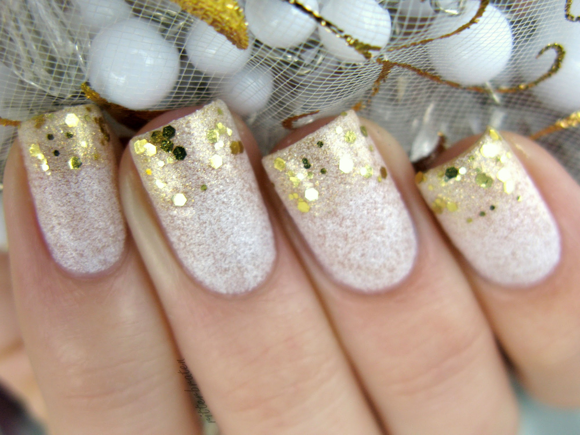 golden glitter over white