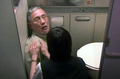 Misaki checks on the man who has collapsed on the bathroom floor.