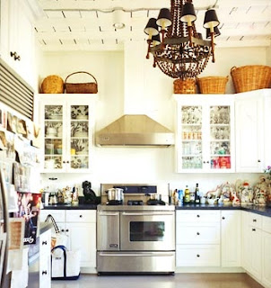 mylittlehousedesign.com large baskets on top of kitchen cabinets