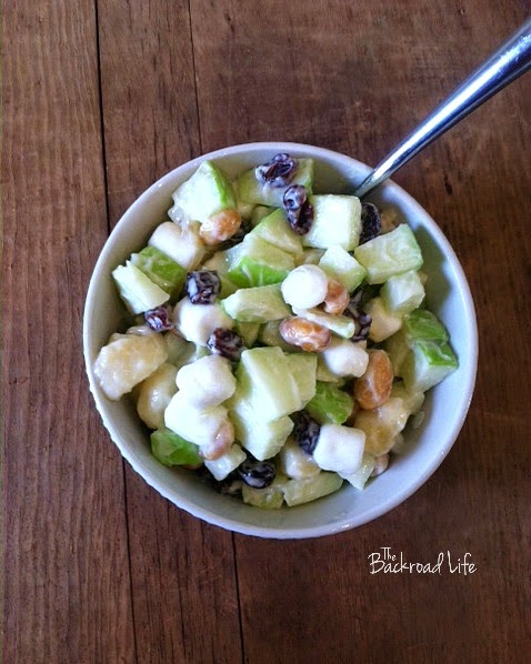 Quick and easy apple salad recipe. Great for simple servings or for large family meals. Fresh apple salad using apples, raisins, bananas, marshmallows, peanuts, and Miracle Whip.