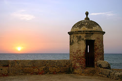 Colonial wall and sunset on the Caribbean