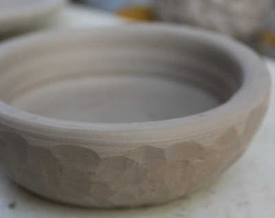 carved clay bowl