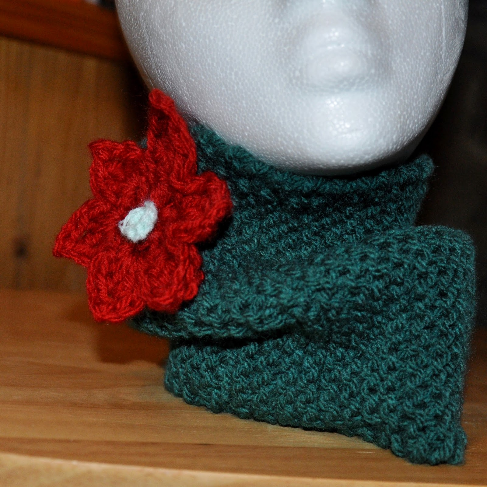 crochet neckwarmer with poinsettia flower