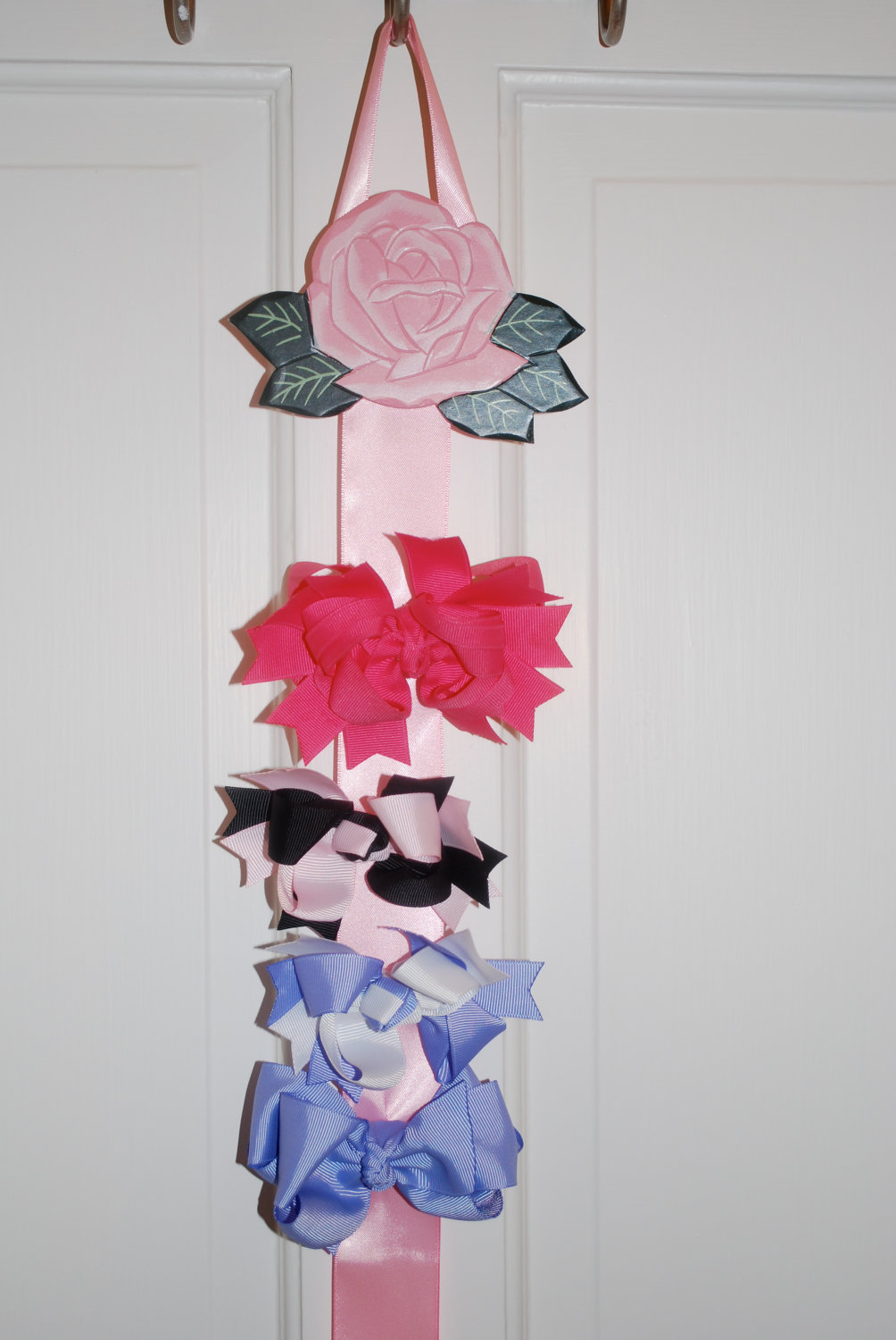 How to organize hair bows - This Pink Rose Bow Holder Can Be Purchased By Etsy Owner Ewe And I