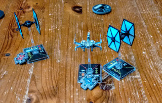 An X Wing and two TIEs