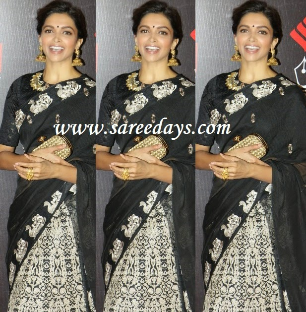 Latest saree designs deepika padukone in black and white designer saree ceckout deepika padukone in black and white designer saree with peacock embroidered border and printed lehenga and paired with matching half sleeves blouse altavistaventures Image collections