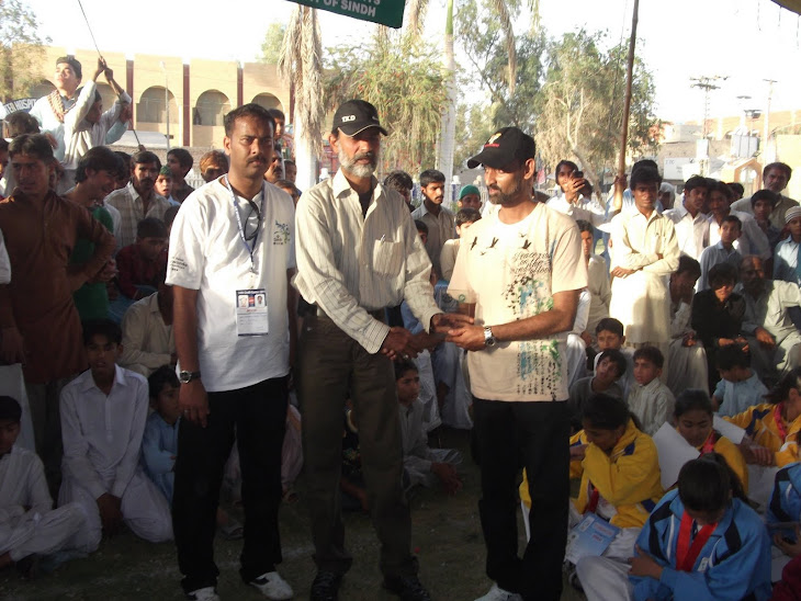 Usman Faraz rcving shield with STA-Sec. Mr.Javed Khan