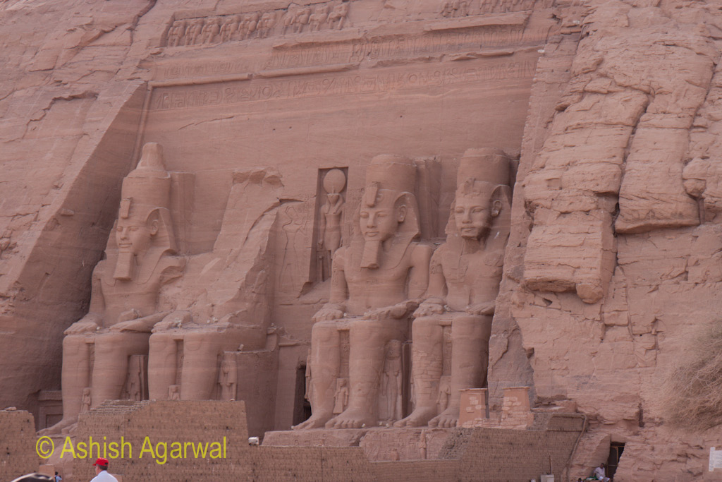 The 4 sitting statues at the Abu Simbel, with one damaged statue out of the 4 statues