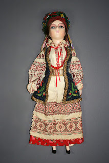 ukranian doll in traditional dress, repair and restoration of dolls and clothes, art conservator in private practice, expert care.