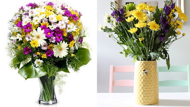 white purple and yellow cheerful daisies bouquet with greenery in yellow bee vase