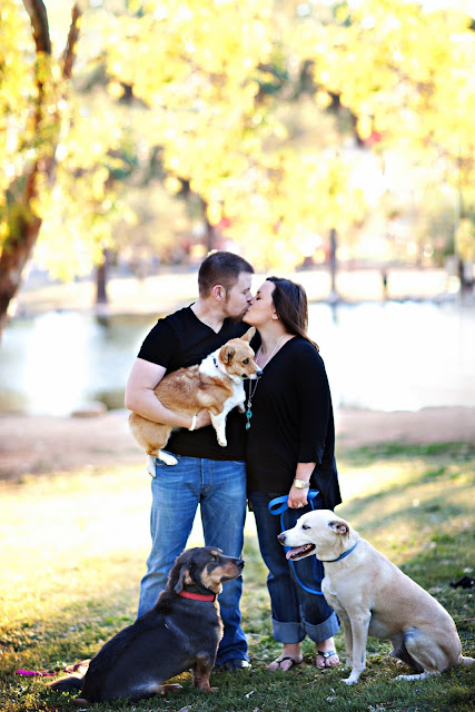 Dog lovers kiss in Tucson park with trees in the background