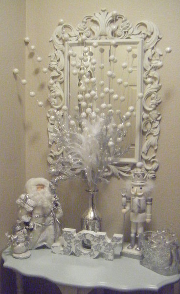 i changed out the entry table from halloween decor to christmas today i love christmas decor so much because i love white and its the one holiday where