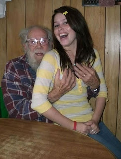 funny picture: girl on lap of grandfather