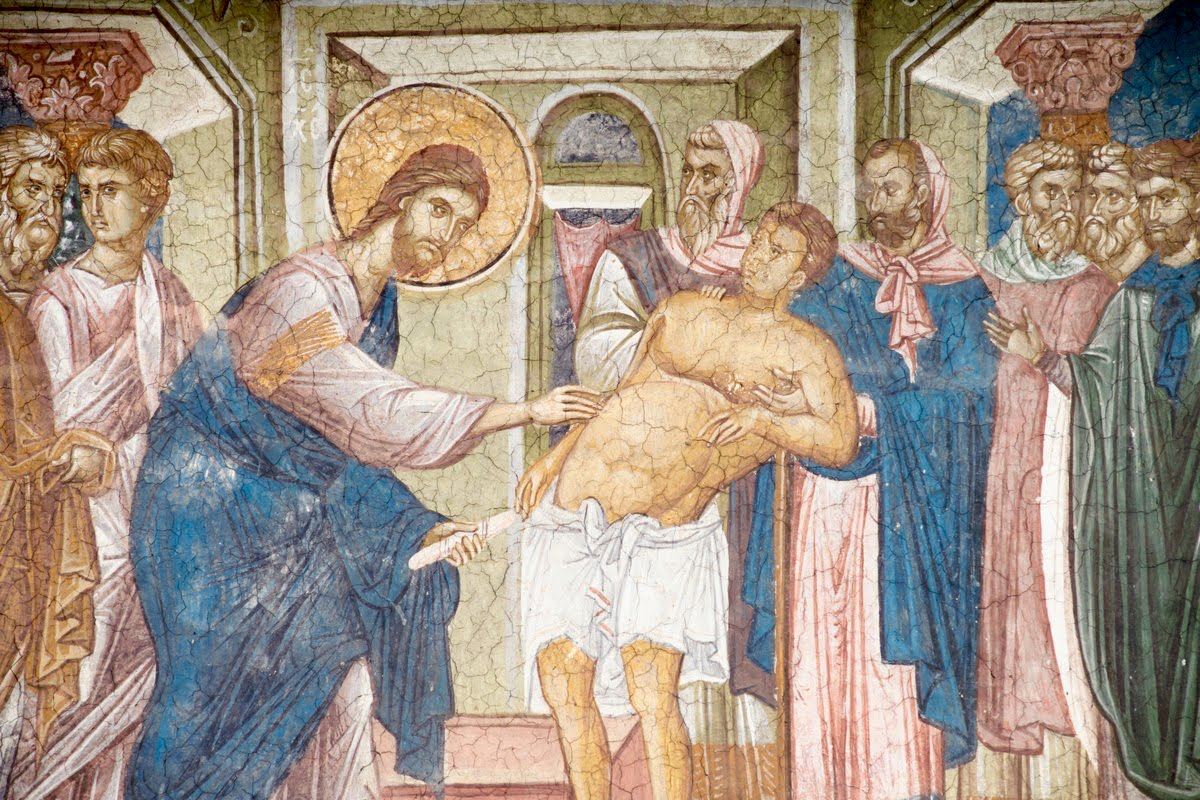 Jesus healing the sick.