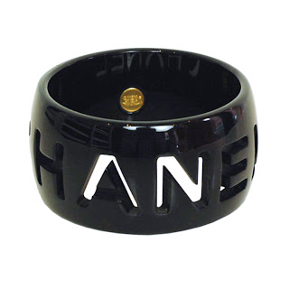 Vintage 1990's black resin Chanel bangle bracelet with cut-out logo.