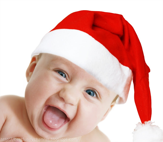 Laughing baby in Christmas cap.